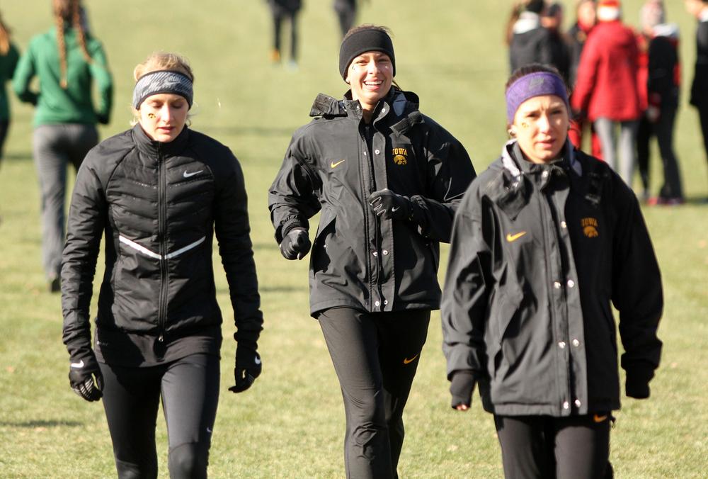 Madison Waymire, Ashley Espinosa, and Marta Gonzalez warm up before the NCAA Midwest Regional.
