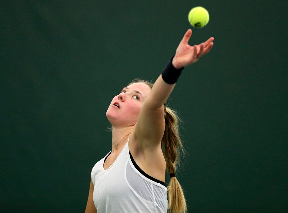 Iowa's Danielle Burich serves during her singles match at the Hawkeye Tennis and Recreation Complex in Iowa City on Sunday, February 23, 2020. (Stephen Mally/hawkeyesports.com)