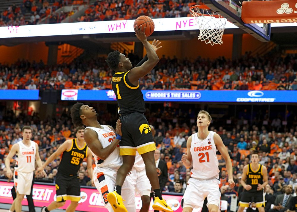 Iowa Hawkeyes guard Joe Toussaint (1) makes a basket during the second half of their ACC/Big Ten Challenge game at the Carrier Dome in Syracuse, N.Y. on Tuesday, Dec 3, 2019. (Stephen Mally/hawkeyesports.com)