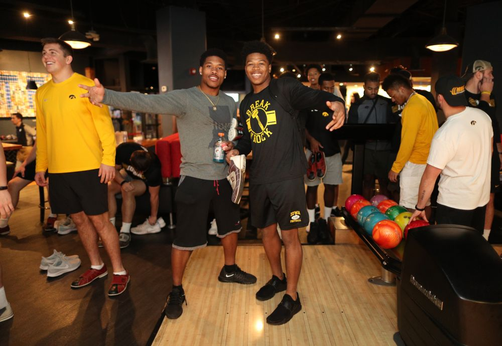 Iowa Hawkeyes wide receiver Tyrone Tracy Jr. (3) and defensive back Kaevon Merriweather (26) during the Players' Night at Splitsville Friday, December 28, 2018 in the Sparkman Wharf area of Tampa, FL.(Brian Ray/hawkeyesports.com)