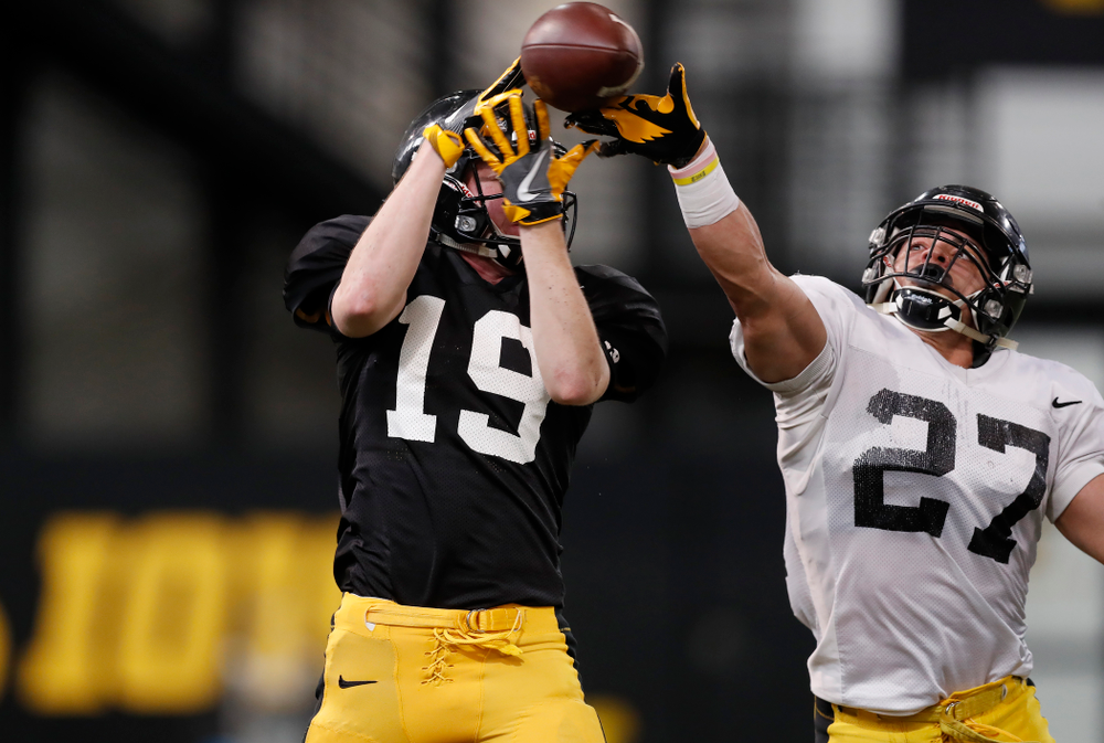 Iowa Hawkeyes wide receiver Max Cooper (19) and defensive back Amani Hooker (27) during spring practice Wednesday, March 28, 2018 at the Hansen Football Performance Center.  (Brian Ray/hawkeyesports.com)