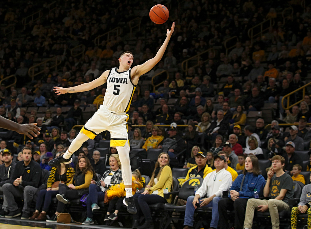 Iowa Hawkeyes guard CJ Fredrick (5) pulls in a pass during the first half of their game at Carver-Hawkeye Arena in Iowa City on Friday, Nov 8, 2019. (Stephen Mally/hawkeyesports.com)