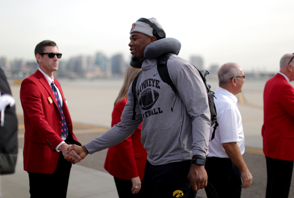 Iowa Hawkeyes defensive end Chauncey Golston (57) shakes hands with the ÒRed CoatsÓ after arriving in San Diego, CA Saturday, December 21, 2019 for the Holiday Bowl. (Brian Ray/hawkeyesports.com)