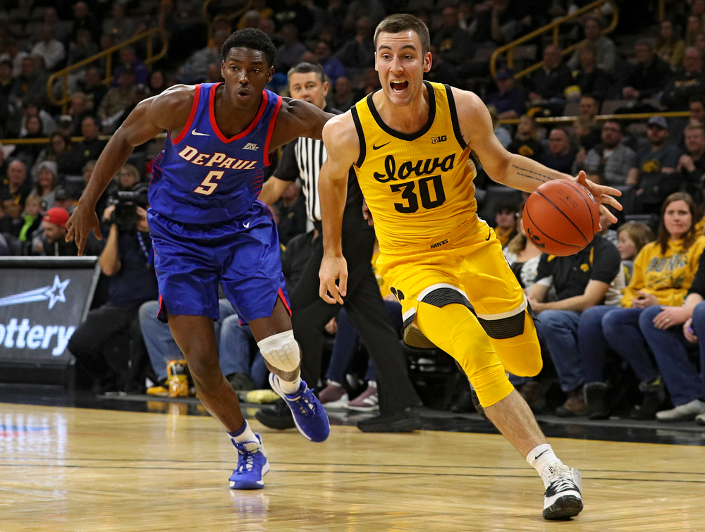 Iowa Hawkeyes guard Connor McCaffery (30) drives to the basket during the first half of their game at Carver-Hawkeye Arena in Iowa City on Monday, Nov 11, 2019. (Stephen Mally/hawkeyesports.com)