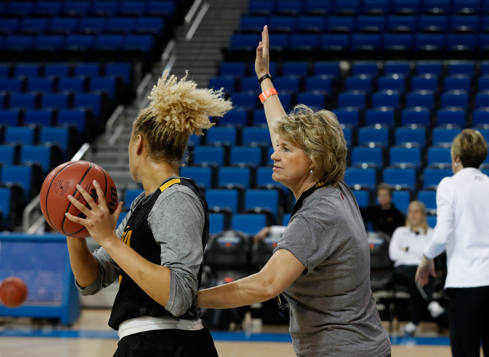 Iowa Hawkeyes forward Chase Coley (4) works against head coach Lisa Bluder during practice Friday, March 16, 2018 at Pauley Pavilion on the campus of UCLA. (Brian Ray/hawkeyesports.com)