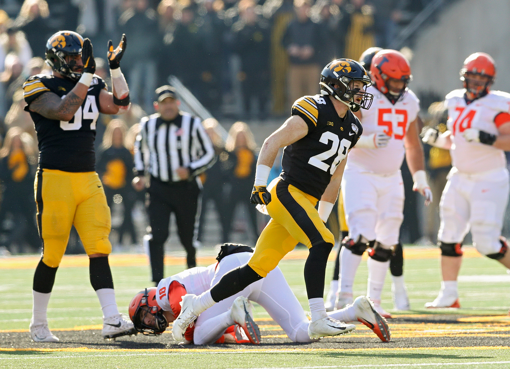Iowa Hawkeyes defensive back Jack Koerner (28) celebrates after Illinois Fighting Illini quarterback Brandon Peters (18) was sacked during the second quarter of their game at Kinnick Stadium in Iowa City on Saturday, Nov 23, 2019. (Stephen Mally/hawkeyesports.com)