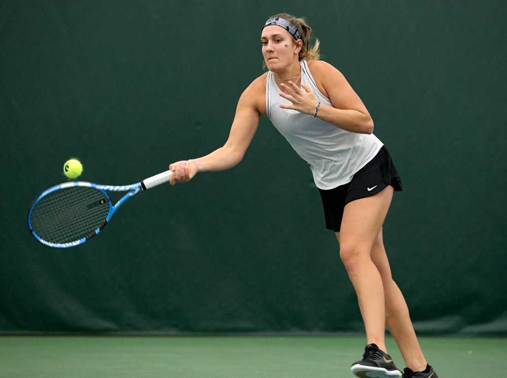 Iowa's Ashleigh Jacobs returns a shot during her doubles match at the Hawkeye Tennis and Recreation Complex in Iowa City on Sunday, February 16, 2020. (Stephen Mally/hawkeyesports.com)