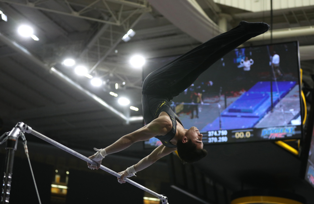 Iowa's Andrew Herrador competes on the high bar against the Ohio State Buckeyes Saturday, March 16, 2019 at Carver-Hawkeye Arena.  (Brian Ray/hawkeyesports.com)