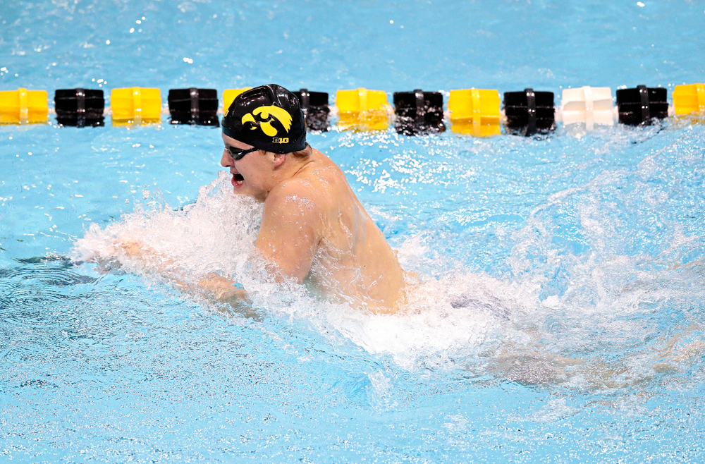 Iowa's William Myhre swims the men's 100 yard individual medley event during their meet at the Campus Recreation and Wellness Center in Iowa City on Friday, February 7, 2020. (Stephen Mally/hawkeyesports.com)