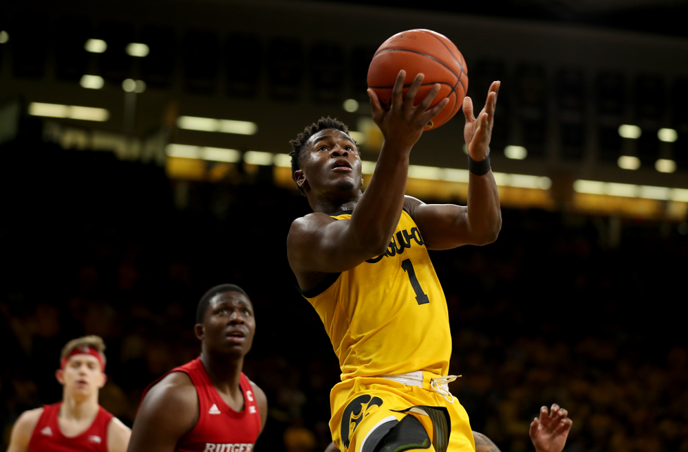 Iowa Hawkeyes guard Joe Toussaint (1) goes to the hoop against the Rutgers Scarlet Knights  Wednesday, January 22, 2020 at Carver-Hawkeye Arena. (Brian Ray/hawkeyesports.com)