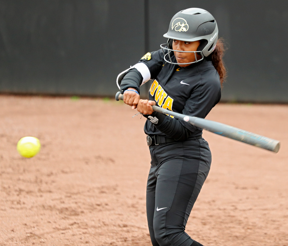 Iowa infielder Nia Carter (14) bats during the fourth inning of their game against Iowa Softball vs Indian Hills Community College at Pearl Field in Iowa City on Sunday, Oct 6, 2019. (Stephen Mally/hawkeyesports.com)