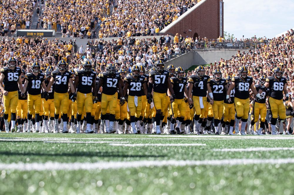 The Iowa Hawkeyes swarm onto the field for their game against the Rutgers Scarlet Knights Saturday, September 7, 2019 at Kinnick Stadium. (Brian Ray/hawkeyesports.com)