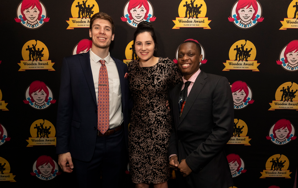 Iowa Hawkeyes forward Megan Gustafson (10) on the red carpet WisconsinÕs Ethan Happ and Michigan StateÕs Cassius Winston before the ESPN College Basketball Awards show Friday, April 12, 2019 at The Novo at LA Live.  (Brian Ray/hawkeyesports.com)