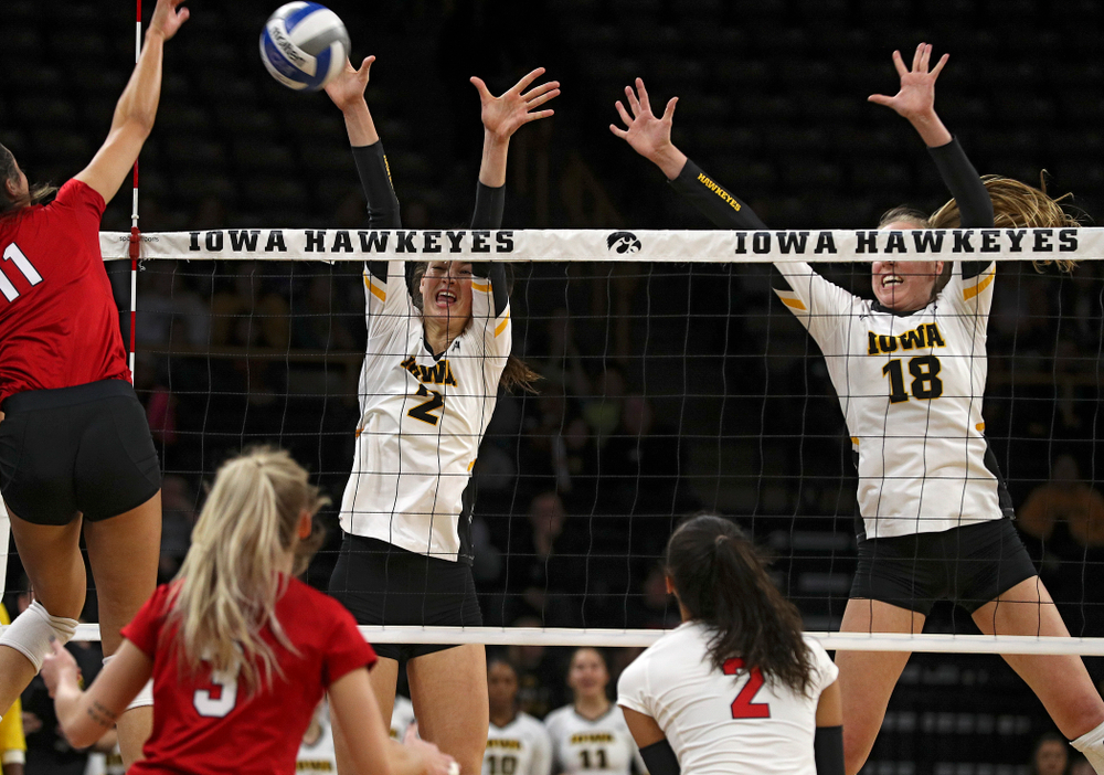 Iowa's Courtney Buzzerio (2) tries for a block as Hannah Clayton (18) looks on during the first set of their match against Nebraska at Carver-Hawkeye Arena in Iowa City on Saturday, Nov 9, 2019. (Stephen Mally/hawkeyesports.com)