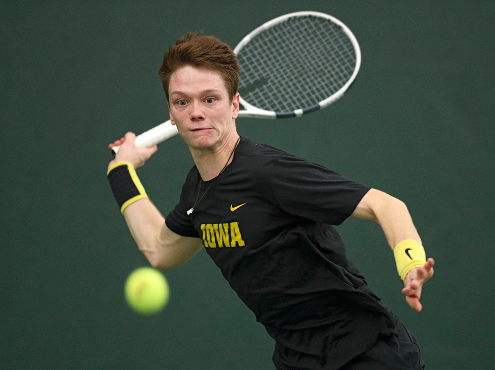 Iowa's Jason Kerst hits a shot during his match against Marquette at the Hawkeye Tennis and Recreation Complex in Iowa City on Saturday, January 25, 2020. (Stephen Mally/hawkeyesports.com)