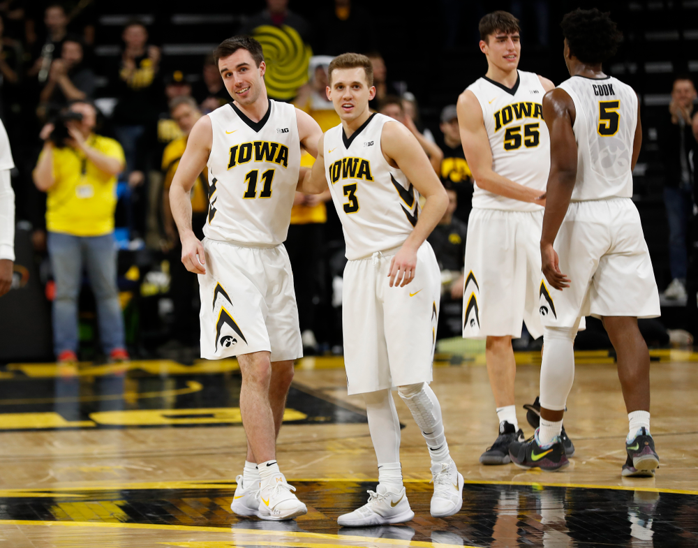 Iowa Hawkeyes forward Charlie Rose (11) and guard Jordan Bohannon (3)