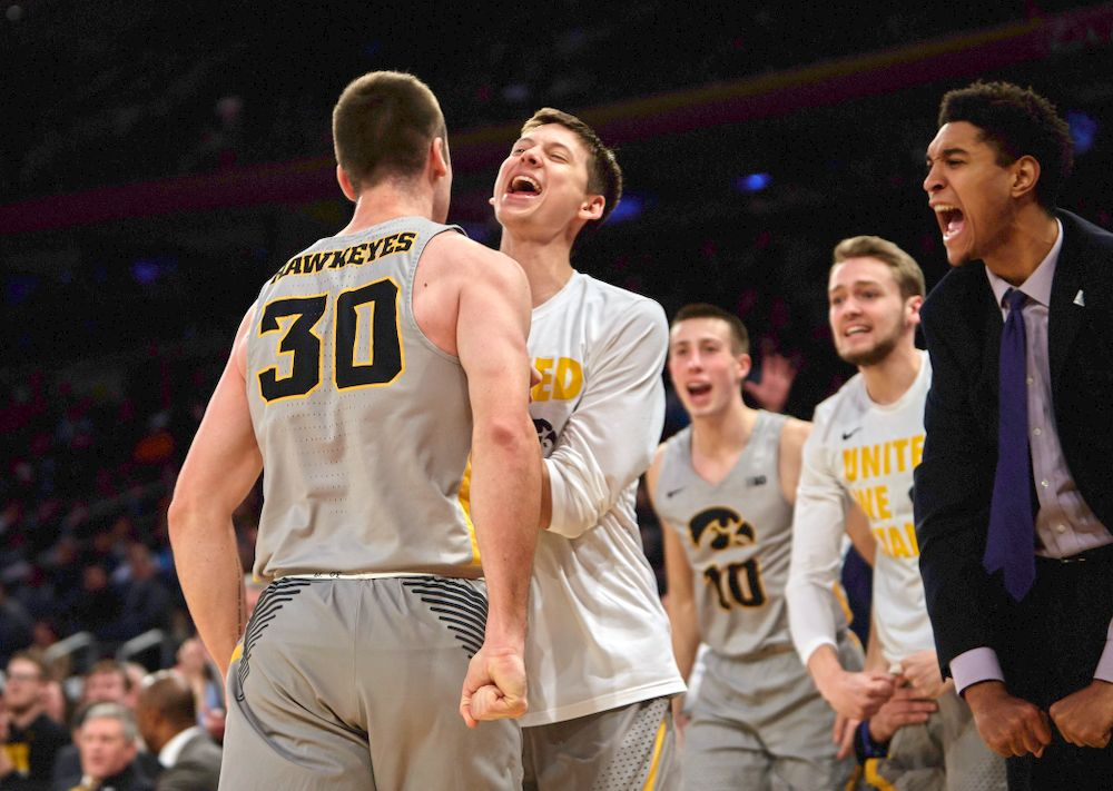 Iowa Hawkeyes guard Connor McCaffery (30) and Iowa Hawkeyes guard Austin Ash (13) against UConn in the Championship game of the 2K Empire Classic Friday, November 16, 2018 at Madison Square Garden in New York City. (Duncan H.Williams/Freelance)