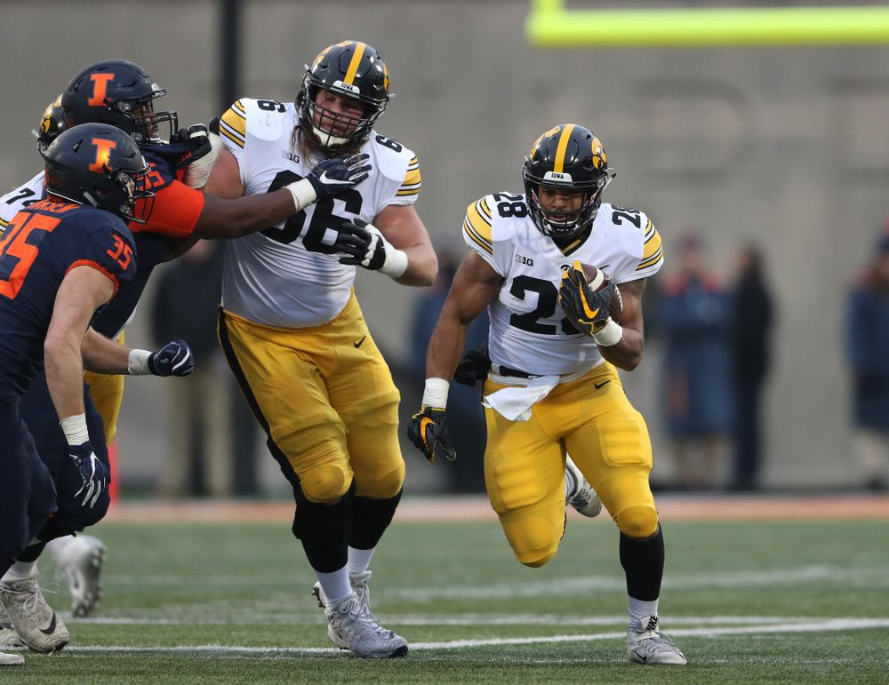 Iowa Hawkeyes running back Toren Young (28) runs behind offensive lineman Levi Paulsen (66) against the Illinois Fighting Illini Saturday, November 17, 2018 at Memorial Stadium in Champaign, Ill. (Brian Ray/hawkeyesports.com)