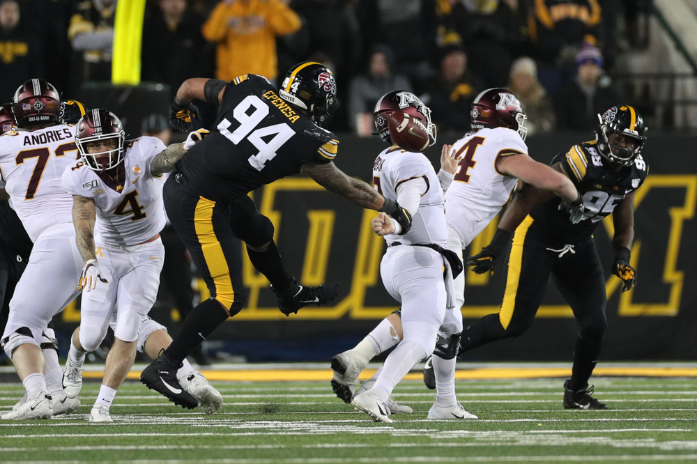 Iowa Hawkeyes defensive end A.J. Epenesa (94) strips the ball against the Minnesota Golden Gophers Saturday, November 16, 2019 at Kinnick Stadium. (Brian Ray/hawkeyesports.com)
