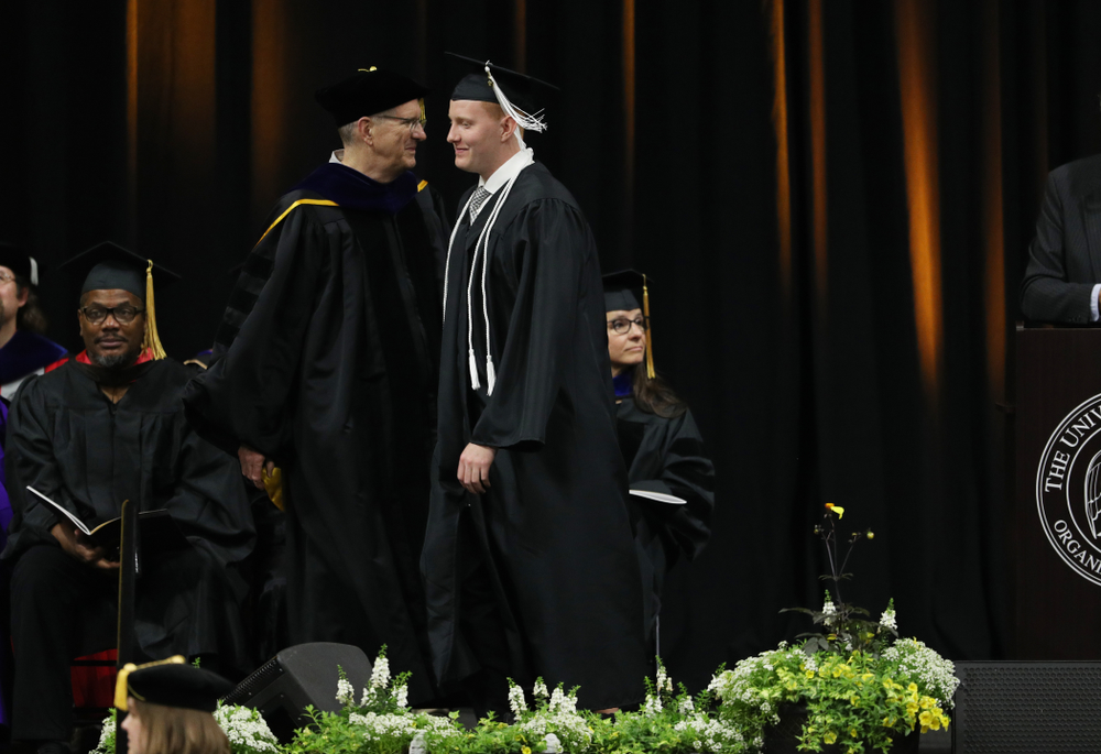 Iowa MenÕs Basketball Manager Trevor Smith during the College of Liberal Arts and Sciences spring commencement Saturday, May 11, 2019 at Carver-Hawkeye Arena. (Brian Ray/hawkeyesports.com)