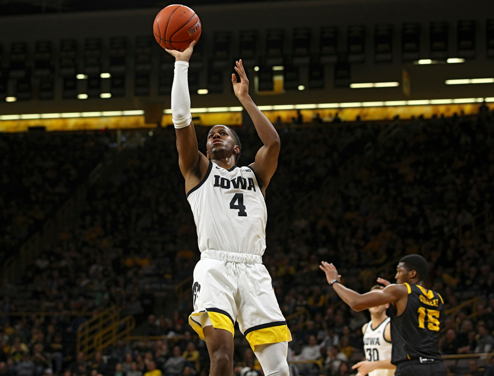 Iowa Hawkeyes guard Bakari Evelyn (4) puts up a shot during the first half of their their game at Carver-Hawkeye Arena in Iowa City on Sunday, December 29, 2019. (Stephen Mally/hawkeyesports.com)