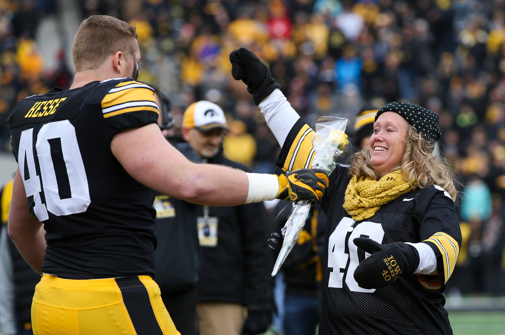 Iowa Hawkeyes defensive end Parker Hesse (40) is greeted by his parents during Senior Day ceremonies before a game against Nebraska at Kinnick Stadium on November 23, 2018. (Tork Mason/hawkeyesports.com)