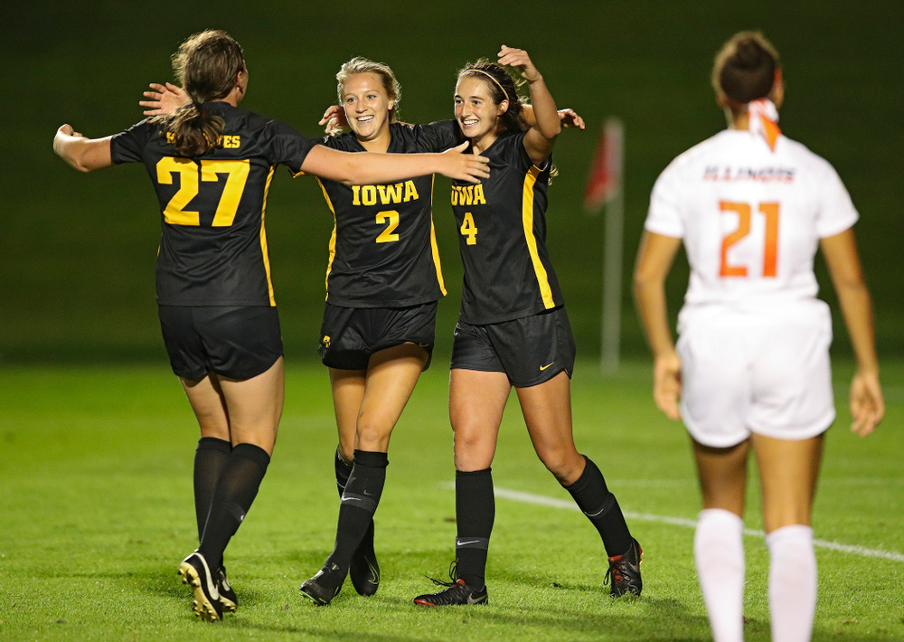 Iowa forward Samantha Tawharu (27), midfielder Hailey Rydberg (2), and forward Kaleigh Haus (4) celebrate together after Haus scored a goal during the second half of their match against Illinois at the Iowa Soccer Complex in Iowa City on Thursday, Sep 26, 2019. (Stephen Mally/hawkeyesports.com)