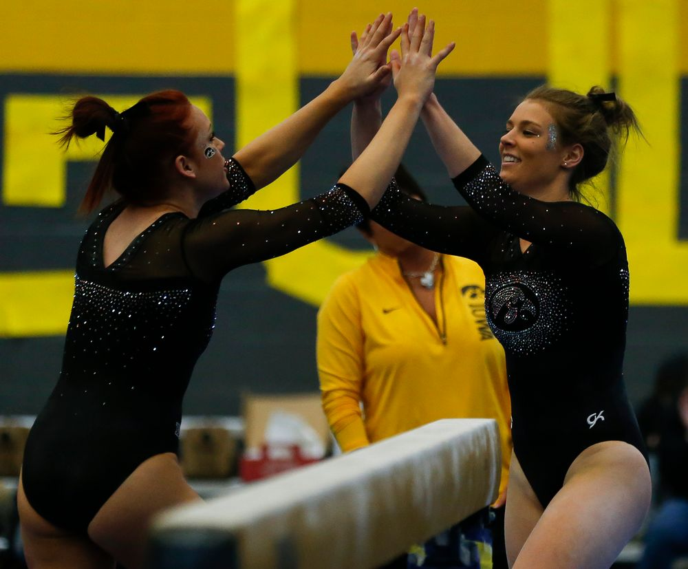 Sydney Hogan celebrates after her balance beam routine during the Black and Gold Intrasquad meet at the Field House on 12/2/17. (Tork Mason/hawkeyesports.com)