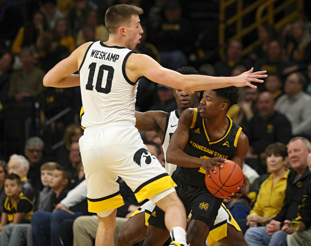 Iowa Hawkeyes guard Joe Wieskamp (10) and guard Joe Toussaint (1) pressure Kennesaw State Owls guard Terrell Burden (1) which leads to a turnover during the first half of their their game at Carver-Hawkeye Arena in Iowa City on Sunday, December 29, 2019. (Stephen Mally/hawkeyesports.com)