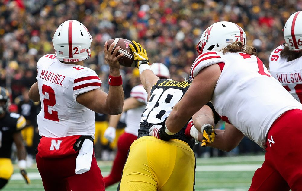 Iowa Hawkeyes defensive end Anthony Nelson (98) knocks the ball out of the quarterback's hand during a game against Nebraska at Kinnick Stadium on November 23, 2018. (Tork Mason/hawkeyesports.com)