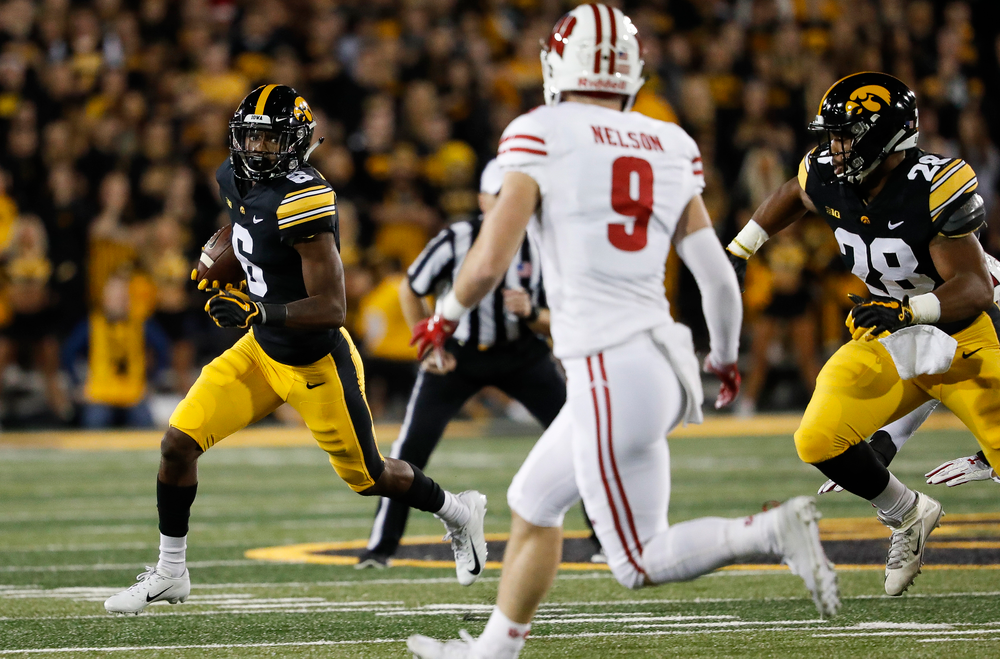 Iowa Hawkeyes wide receiver Ihmir Smith-Marsette (6) runs the ball during a game against Wisconsin at Kinnick Stadium on September 22, 2018. (Tork Mason/hawkeyesports.com)