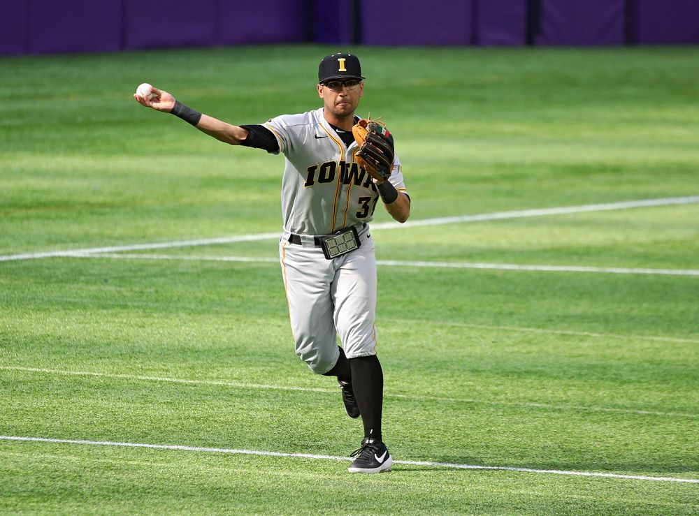 Iowa Hawkeyes infielder Matthew Sosa (31) throws to first during the third inning of their CambriaCollegeClassic game at U.S. Bank Stadium in Minneapolis, Minn. on Friday, February 28, 2020. (Stephen Mally/hawkeyesports.com)