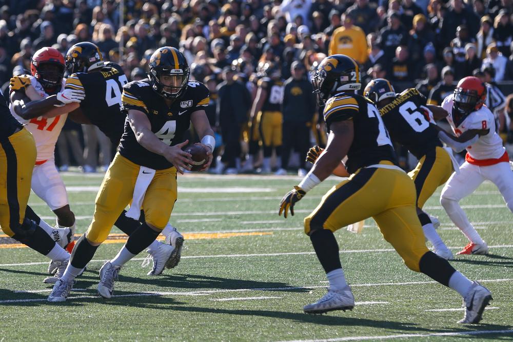 Iowa Hawkeyes quarterback Nate Stanley (4) and Iowa Hawkeyes running back Toren Young (28) during Iowa football vs Illinois on Saturday, November 23, 2019 at Kinnick Stadium. (Lily Smith/hawkeyesports.com)