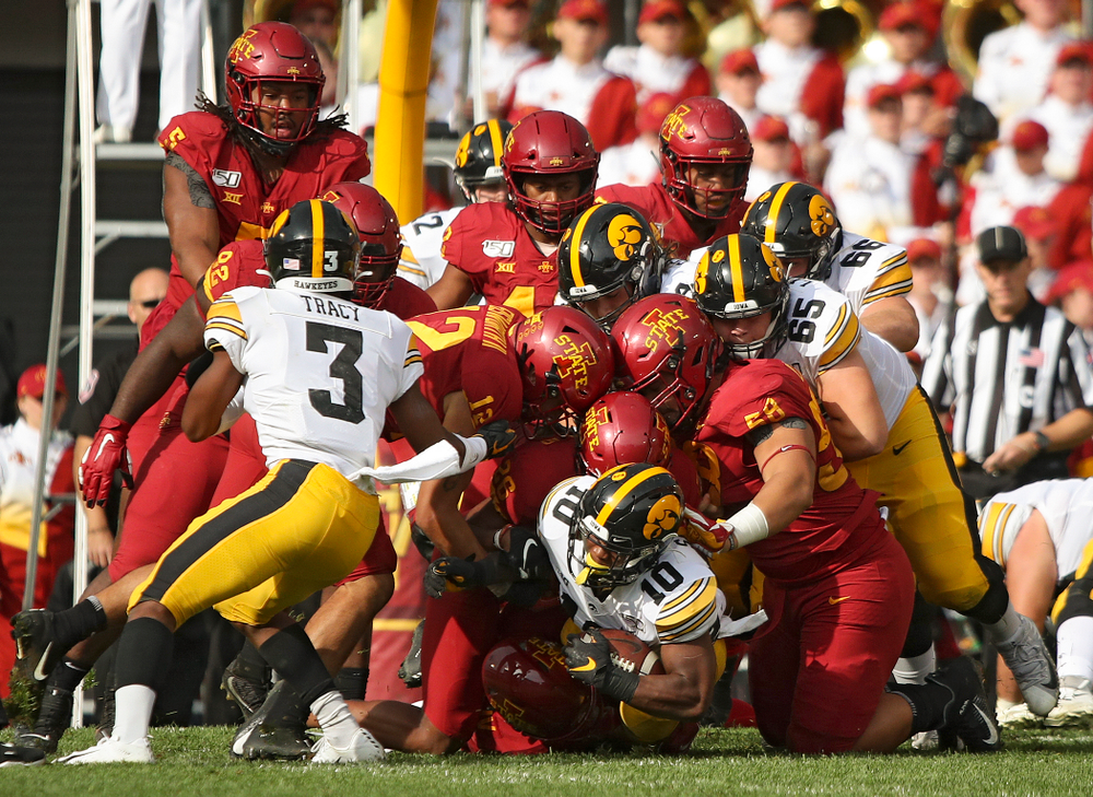Iowa Hawkeyes running back Mekhi Sargent (10) pushes for extra yards on a run during the first quarter of their Iowa Corn Cy-Hawk Series game at Jack Trice Stadium in Ames on Saturday, Sep 14, 2019. (Stephen Mally/hawkeyesports.com)