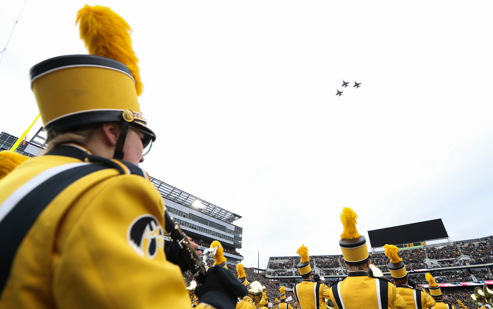 Three F-18 Hornets fly over the stadium as the Hawkeye Marching Band performs the National Anthem before a game against Northwestern at Kinnick Stadium on November 10, 2018. (Tork Mason/hawkeyesports.com)