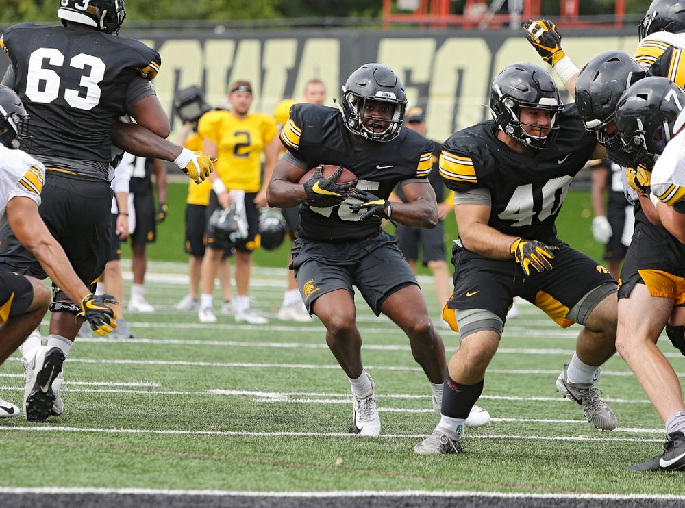 Iowa Hawkeyes running back Tyler Goodson (15) on a run during Fall Camp Practice No. 15 at the Hansen Football Performance Center in Iowa City on Monday, Aug 19, 2019. (Stephen Mally/hawkeyesports.com)