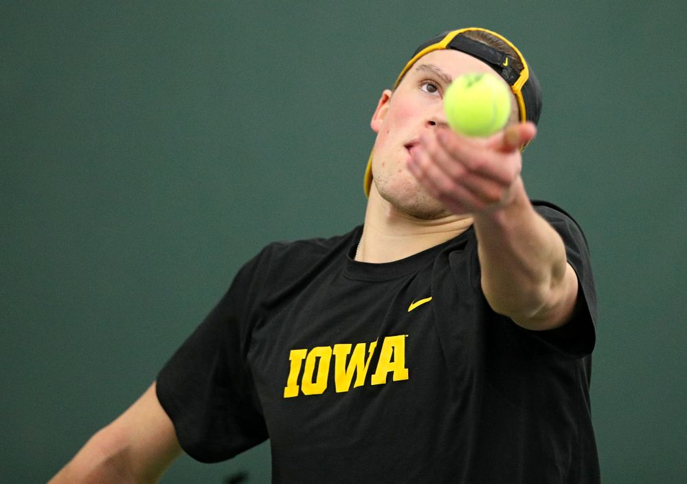 Iowa's Joe Tyler serves during his singles match at the Hawkeye Tennis and Recreation Complex in Iowa City on Friday, February 14, 2020. (Stephen Mally/hawkeyesports.com)