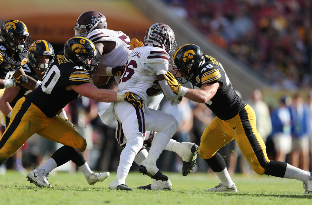 Iowa Hawkeyes defensive end Parker Hesse (40) and linebacker Jack Hockaday (48) during their Outback Bowl Tuesday, January 1, 2019 at Raymond James Stadium in Tampa, FL. (Brian Ray/hawkeyesports.com)