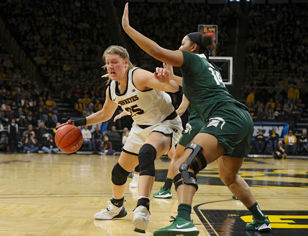 Iowa Hawkeyes forward Monika Czinano (25) drives with the ball during the second quarter of their game at Carver-Hawkeye Arena in Iowa City on Sunday, January 26, 2020. (Stephen Mally/hawkeyesports.com)