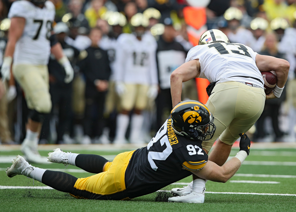 Iowa Hawkeyes defensive lineman John Waggoner (92) sacks Purdue Boilermakers quarterback Jack Plummer (13) during the second quarter of their game at Kinnick Stadium in Iowa City on Saturday, Oct 19, 2019. (Stephen Mally/hawkeyesports.com)