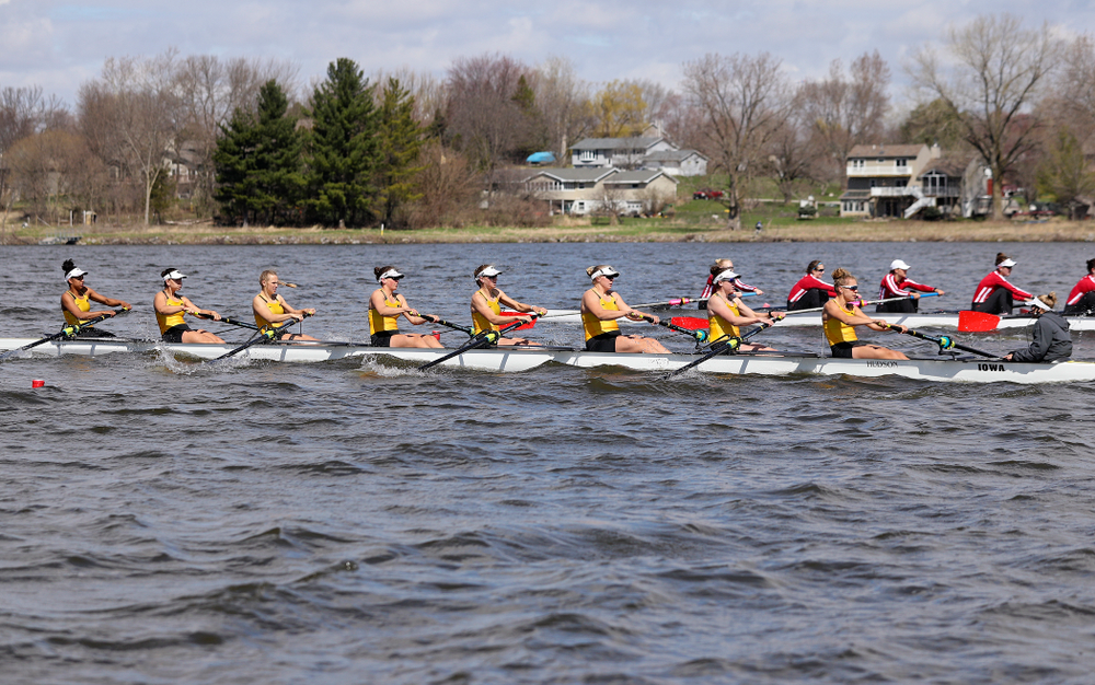 Iowa's Naomi Visser (from left), Elena Waiglein, Paige Schlapkohl, Hannah Greenlee, Hunter Koenigsfeld, Contessa Harold, Katie Pearson, Eve Stewart, and Logan Jones during their 1 Varsity 8 race against Wisconsin in their Big Ten Double Dual Rowing Regatta at Lake Macbride in Solon on Saturday, Apr. 13, 2019. (Stephen Mally/hawkeyesports.com)