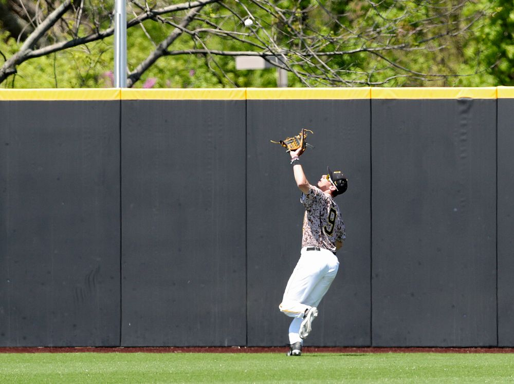 Iowa Hawkeyes center fielder Ben Norman (9) pulls in a fly ball for an out during the second inning of their game against UC Irvine at Duane Banks Field in Iowa City on Sunday, May. 5, 2019. (Stephen Mally/hawkeyesports.com)