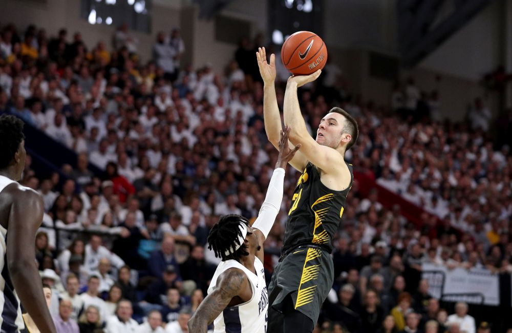 Iowa Hawkeyes guard Connor McCaffery (30) pulls up for a shot against Penn State Friday, January 3, 2020 at the Palestra in Philadelphia. (Brian Ray/hawkeyesports.com)