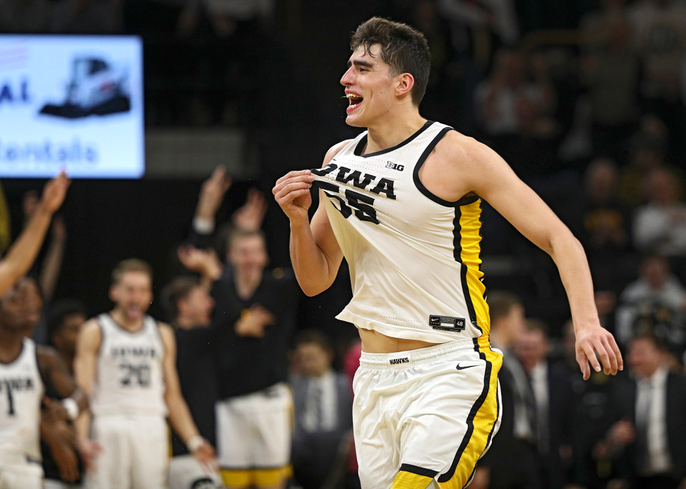 Iowa Hawkeyes center Luka Garza (55) celebrates after a score during the second half of the game at Carver-Hawkeye Arena in Iowa City on Sunday, February 2, 2020. (Stephen Mally/hawkeyesports.com)