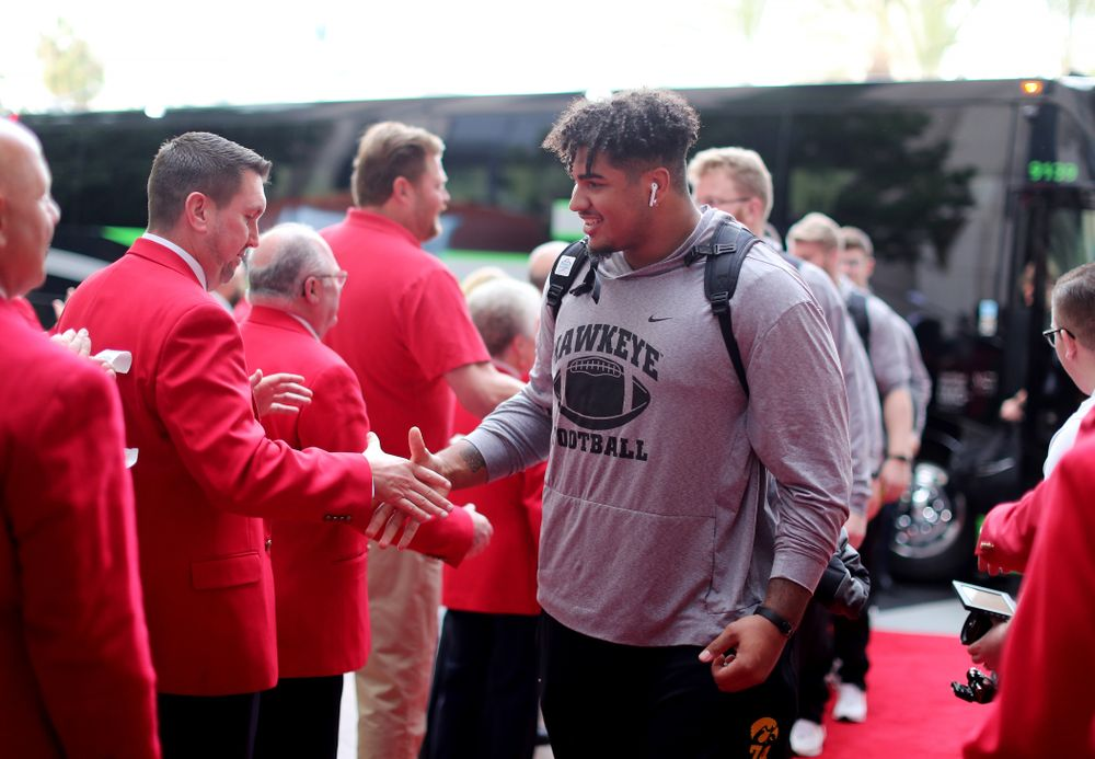 Iowa Hawkeyes offensive lineman Tristan Wirfs (74) shakes hands with the ÒRed CoatsÓ after arriving in San Diego, CA Saturday, December 21, 2019 for the Holiday Bowl. (Brian Ray/hawkeyesports.com)