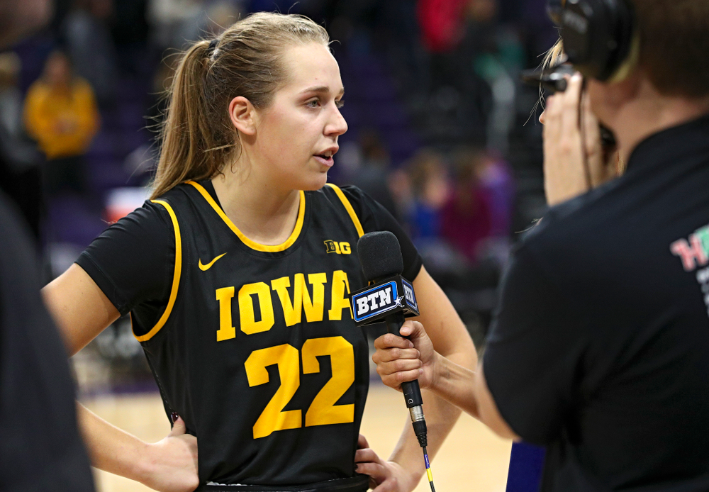Iowa Hawkeyes guard Kathleen Doyle (22) is interviewed after winning their game at Welsh-Ryan Arena in Evanston, Ill. on Sunday, January 5, 2020. (Stephen Mally/hawkeyesports.com)