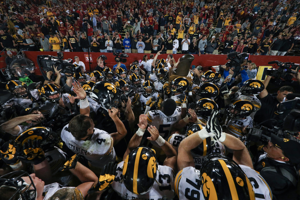 The Iowa Hawkeyes sing the Fight Song with the Cy-Hawk trophy following their game against the Iowa State Cyclones Saturday, September 14, 2019 in Ames, Iowa. (Brian Ray/hawkeyesports.com)