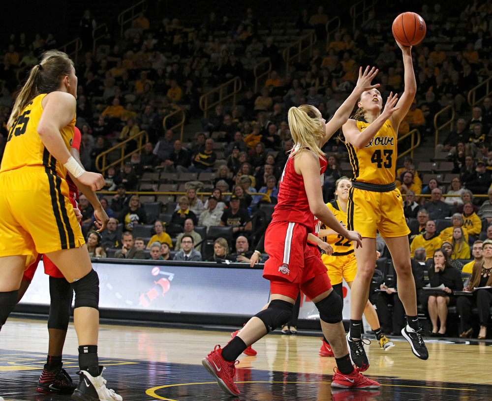 Iowa Hawkeyes forward Amanda Ollinger (43) makes a basket during the fourth quarter of their game at Carver-Hawkeye Arena in Iowa City on Thursday, January 23, 2020. (Stephen Mally/hawkeyesports.com)