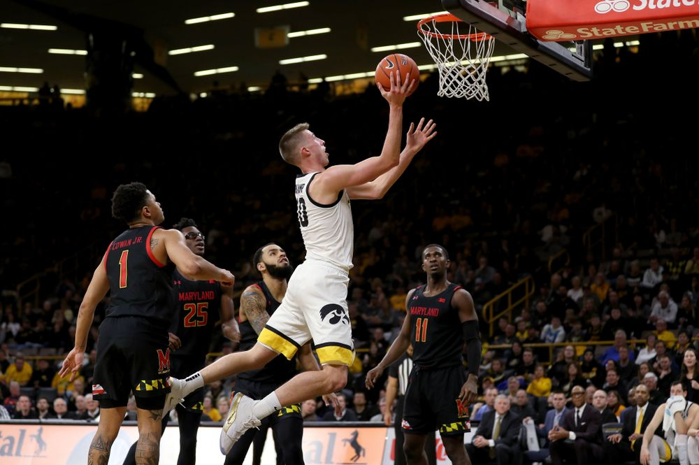 Iowa Hawkeyes guard Joe Wieskamp (10) draws a foul as he makes a basket against the Maryland Terrapins Friday, January 10, 2020 at Carver-Hawkeye Arena. (Brian Ray/hawkeyesports.com)