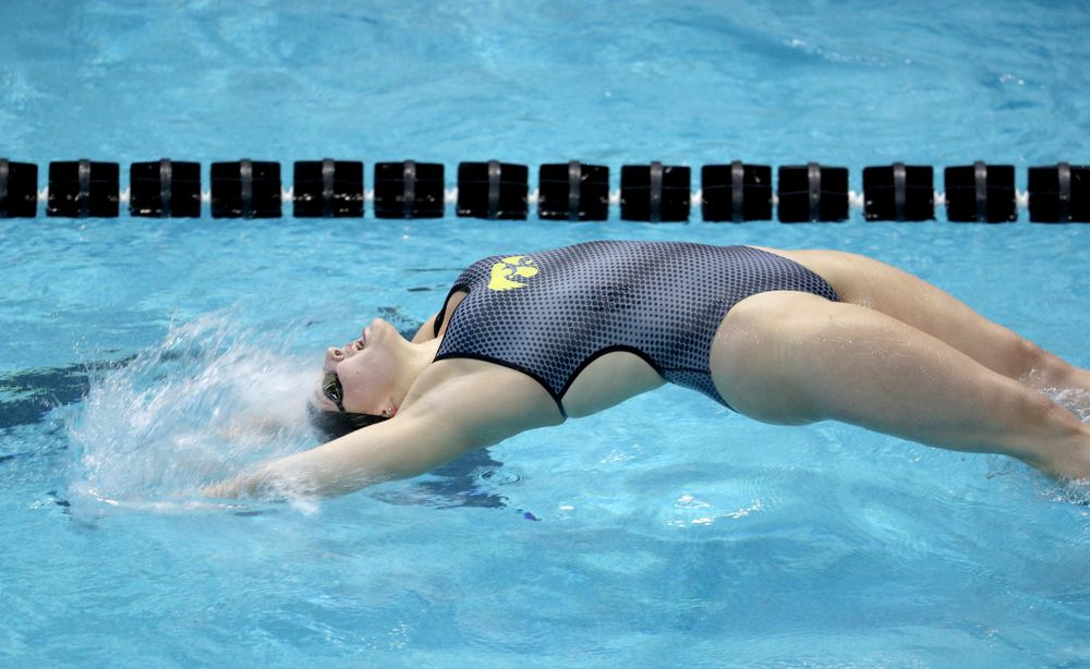 IowaÕs Emilia Sansome competes in the 100 yard backstroke against Notre Dame and Illinois Saturday, January 11, 2020 at the Campus Recreation and Wellness Center.  (Brian Ray/hawkeyesports.com)